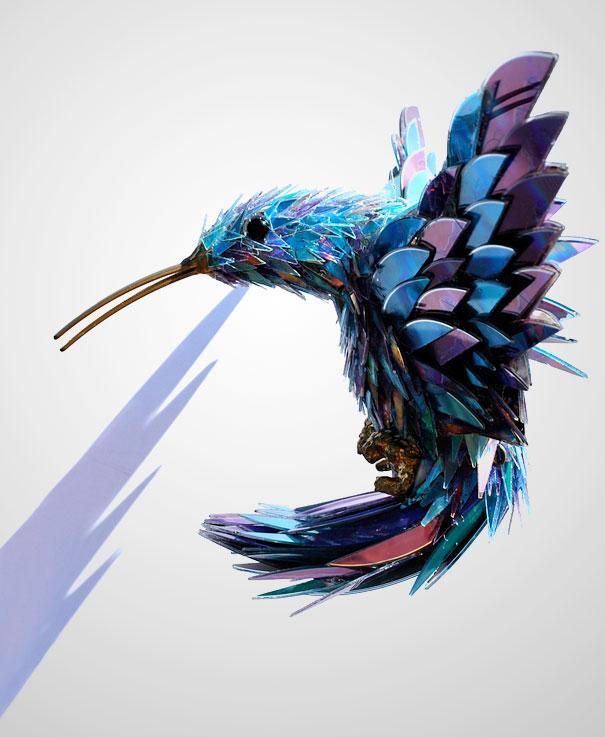 Escultura pájaro hecha con CD reciclados - La Tienda Home